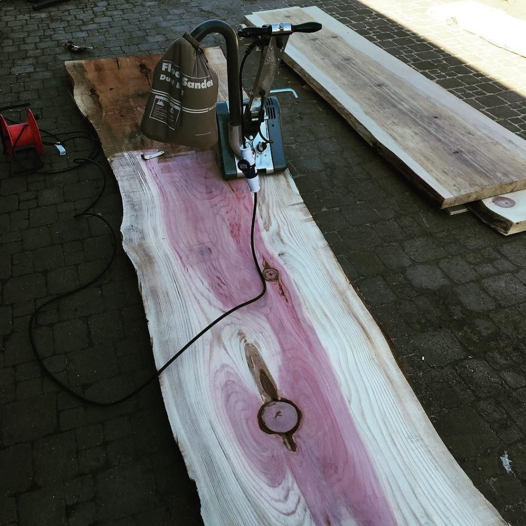 Sanding the first slab off my redwood planted in 1853 it was amongst the first batch of redwoods planted in the UK. It's approximately 3.6m 0.9m x75mm
