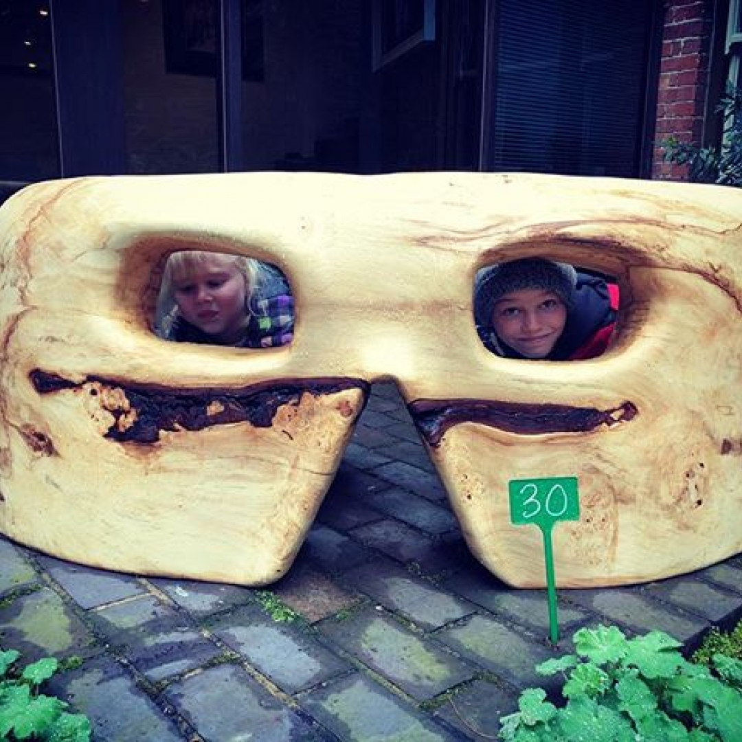 My kids hiding in my sculpture at @turn_end_trust open again tomorrow I used an @arbortechie grinder to make this. #alaskanmill #sawmillbusiness